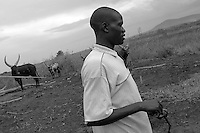 Empowering Victims of War- A young man living on the farm. Canaan Family Farm lends land to displaced people from the Northern conflict to have them learn the benefits of work and empowerment. Rwakayata, Masindi, Uganda, Africa. December 2005 © Stephen Blake Farrington