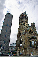 "Kaiser Wilhelm Memorial Church was badly damaged in a bombing raid in 1943. A new controversial church was built sometimes called ""Lippenstift und Puderdose"" (the lipstick and the powder box) by Berliners"