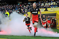 Alistair Hargreaves of Saracens, mascot in hand, runs out onto the field. Aviva Premiership match, between Saracens and Worcester Warriors on November 28, 2015 at Twickenham Stadium in London, England. Photo by: Patrick Khachfe / JMP