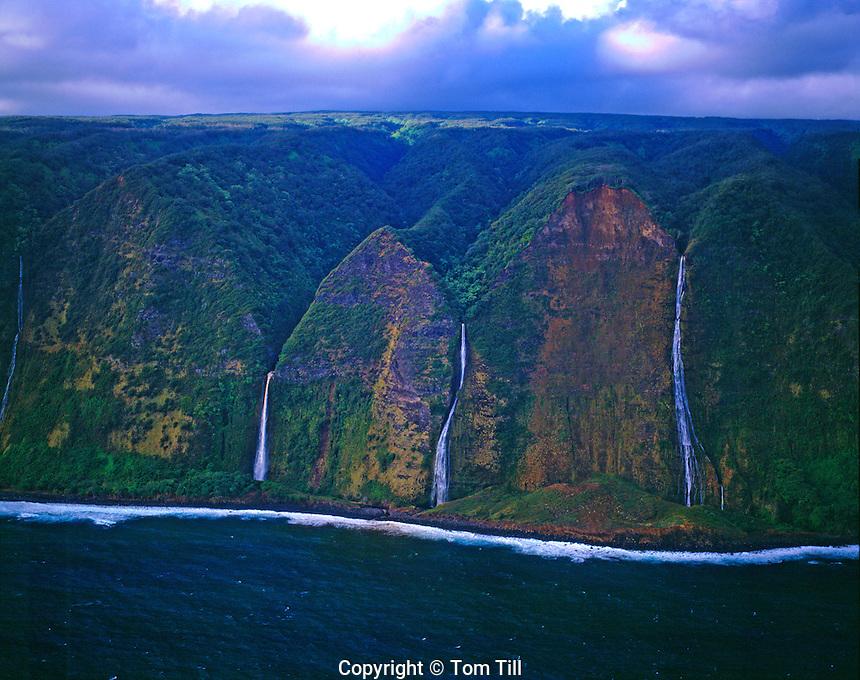 Falls tumbling into ocean  Kohala Coast Big Island of Hawaii  Kohala Mountains  Morning  Pacific Ocean  March
