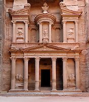 Treasury of the Pharaohs or Khazneh Firaoun, 100 BC - 200 AD, Petra, Ma'an, Jordan. Originally built as a royal tomb, the treasury is so called after a belief that pirates hid their treasure in an urn held here. Carved into the rock face opposite the end of the Siq, the 40m high treasury has a Hellenistic facade with three bare inner rooms. Petra was the capital and royal city of the Nabateans, Arabic desert nomads. Picture by Manuel Cohen