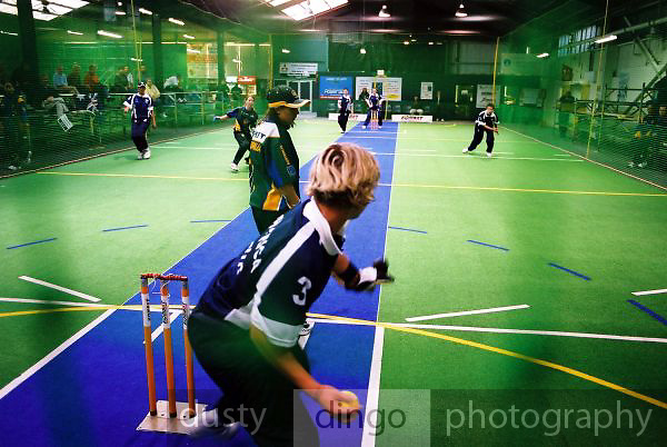 South Africa Under 19 Girls' wicket keeper, Monique de Buys, shapes to throw, vs Australia.<br /> 2003 Indoor Cricket World Under 19 Championships, Christchurch, New Zealand