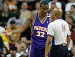 Phoenix Suns' Amare Stoudemire, l, talks to referee Olandis Poole, r, after picking up a technical foul against the Seattle Supersonics'  in the first quarter at Key Arena in Seattle, Washington  on Sunday, 06 March 2005.  Jim Bryant Photo. ©2010. All Rights Reserved.