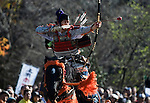 "Dressed in ornate period costume, a member of the Toyama-ryu ""yabusame"" horseback archery group takes aim at a target during a yabusame ritual in Machida, western Tokyo, Japan on Nov. 28 2010. During the late Heian era (794 to 1185) and Kamakura era (1185-1333) such archery was the domain of high-ranked samurai and was used as a military training exercise to keep samurai prepared for war. .Photographer: Robert Gilhooly"