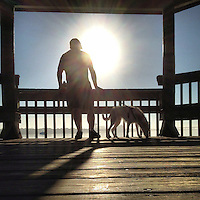 A man and his dog on riverside dock in Holly Hill, FL, iPhone photo from the instgram photostream of bcpix, Florida-based freelance photographer Brian Cleary. (Photo by Brian Cleary/www.bcpix.com)