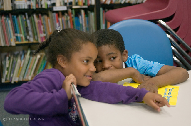 Oakland CA 1st- 2nd grade students sharing secret on trip to school library
