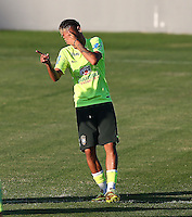Neymar of Brazil enjoys a joke during training ahead of tomorrow's World Cup quarter final vs Colombia