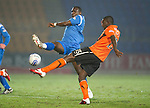 St Johnstone v Dundee United....22.02.11 .Prince Buaben is closed down by Cleveland Taylor.Picture by Graeme Hart..Copyright Perthshire Picture Agency.Tel: 01738 623350  Mobile: 07990 594431