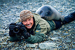 Art Wolfe shares a moment with a southern elephant seal during filming for Travels to the Edge on South Georgia Island