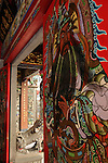 Bao-jhong Yi-min Temple, Kaohsiung -- Guardian deity standing watch at the temple entrance.