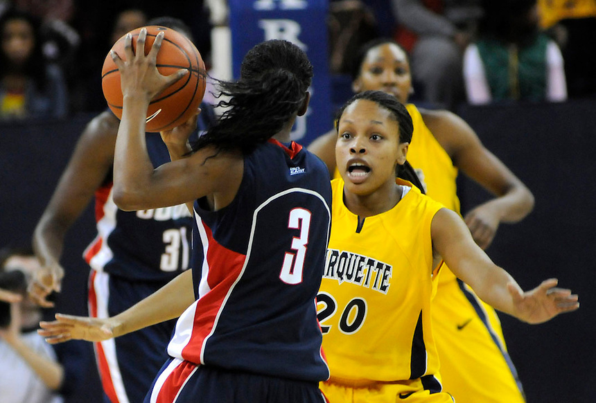 Marquette University's Krystal Ellis defends against Uconn Connecticut Huskies Tiffany Hayes during the first half of the game Saturday, Feb. 7 at the McGuire Center in Milwaukee. Ernie Mastroianni photo.