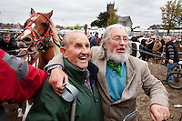 4/10/2010. John Mc Cullen and Fingers Gallagher are pictured watching the trotters at the Ballinasloe Horse Fair, Ballinasloe, Ireland. Picture James Horan