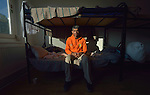 "Modaser Ali, 30, sits on his bed in a government-run refugee center in Vamosszabadi, Hungary. Hungarian Interchurch Aid, a member of the ACT Alliance, provides child care and other services to residents in the center, who come from Syria, Iraq and other countries and are bound for western Europe. Ali is from Pakistan, and said he wants to go to Italy. ""Pakistan is poor. I am poor. I want to work,"" he said."
