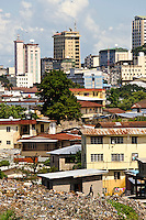Modern high-rise buildings next to a large dump, Freetown, Sierra Leone. Planting Promise is an organization dedicated to the development of education in Sierra Leone. Its aim is to bring opportunities to initiate self-run, self-supporting projects that offer real solutions to the difficulties facing the world's poorest country. They believe real and lasting development comes from below, from local projects that address specific needs, rather than large international models. To this end, they currently run five projects that aim to bring wealth into the country through business. The profits from these businesses are then used to support free education for children and adults...Through the combination of business with social progress, the charity hopes that they are providing real, lasting and profound changes for the better, by promoting sustainable and beneficial industry in the country, and putting it to the service to the needs of the people. As well as providing the income to fund the school, the farms will also be an example of successful commercial enterprise to teach the children in the school the viability of profit-making schemes that go beyond subsistence models, the only things the children of these desperately poor areas are accustomed to. By learning particular details of the challenges that they will face, the children will emerge from this school equipped to contribute in a real way to their society.