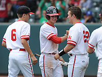 NWA Democrat-Gazette/ANDY SHUPE<br /> Harding Academy center fielder Dalton Koch (center) is congratulated Friday, May 19, 2017, after scoring a run against Greenland during the Class 3A state championship game at Baum Stadium in Fayetteville. Visit nwadg.com/photos to see more photographs from the game.