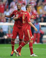 FUSSBALL   1. BUNDESLIGA  SAISON 2011/2012   5. Spieltag FC Bayern Muenchen - SC Freiburg         10.09.2011 Jubel nach dem Tor Jerome Boateng, Nils Petersen (v. li., FC Bayern Muenchen)