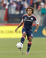 New England Revolution defender Kevin Alston (30) traps the ball. In a Major League Soccer (MLS) match, Toronto FC defeated New England Revolution, 1-0, at Gillette Stadium on July 14, 2012.