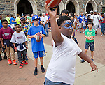 Jamaurie Long, 9, of Durham, aims a ball at a target in the Employee Fun Zone area before the season opener against North Carolina Central University. Duke faculty and staff helped cheer on the Blue Devils during the Employee Kickoff Celebration and season opener against North Carolina Central University. Duke won the game 49-6 at the newly renovated Brooks Field at Wallace Wade Stadium.