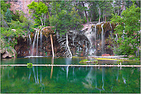 The emerald waters of Hanging Lake are so clear you can sit and watch the trout swim by. In this image of this Colorado icon, you you can see several trout in the lower portion of the crystal clear water. Arrive early (I hiked up in the dark) and you'll often enjoy this scene all by yourself. I stayed for nearly an hour before heading back down. It was a lovely summer morning.