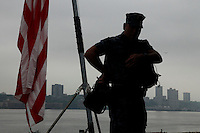 New York, USA. 22nd May, 2014. A Navy member is seen at pier 92 in Manhattan during the Fleet Week in New York.  Kena Betancur/VIEWpress