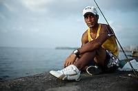 Images from the old Havana, Cuba, Latin America. ..One of the many fishermen in the malecon.  This one sports a very branded outfit, not that unsual and contradicory to what I might have expeceted.  I assme that those with familes abroad, or more closely linked to tourism get access to goods that other portions of the population cannot.