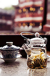Teapot with white silver needle nd jasmin teas on a table at a traditional tea house interior in the old town of Shanghai, China