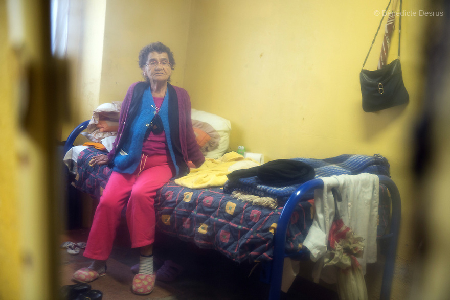 Marie Lou, a resident of Casa Xochiquetzal, portrayed in her bedroom at the shelter in Mexico City, Mexico on February 10, 2017. Casa Xochiquetzal is a shelter for elderly sex workers in Mexico City. It gives the women refuge, food, health services, a space to learn about their human rights and courses to help them rediscover their self-confidence and deal with traumatic aspects of their lives. Casa Xochiquetzal provides a space to age with dignity for a group of vulnerable women who are often invisible to society at large. It is the only such shelter existing in Latin America. Photo by Bénédicte Desrus