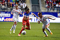 Oct 26, 2014; Philadelphia, PA, USA; United States forward Christen Press (14) works past Costa Rica defender Lixy Rodríguez (12) and Wendy Patricia Acosta (20) during the CONCACAF Women's Championship at PPL Park. Mandatory Credit: Derik Hamilton-USA TODAY Sports