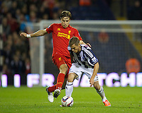 WEST BROMWICH, ENGLAND - Wednesday, September 26, 2012: Liverpool's Sebastian Coates in action against West Bromwich Albion's Markus Rosenberg during the Football League Cup 3rd Round match at the Hawthorns. (Pic by David Rawcliffe/Propaganda)