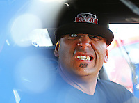 Sep 3, 2016; Clermont, IN, USA; NHRA pro mod driver Justin Shearer , also known as Big Chief from the Discovery Channel television show Street Outlaws reacts as he sits in his car during qualifying for the US Nationals at Lucas Oil Raceway. Mandatory Credit: Mark J. Rebilas-USA TODAY Sports