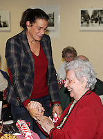 Princess Stephanie of Monaco hands  out Christmas gifts to senior people