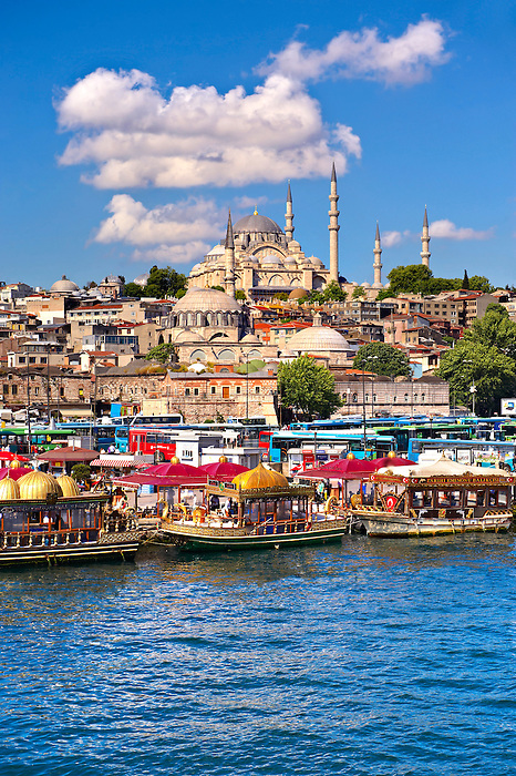 The Suleymaniye Mosque (Süleymaniye Camii, 1550-1558)  on the Third Hill and boats selling cooked fish on the banks of the Golden Horn, Istanbul Turkey.