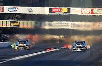 Nov 8, 2013; Pomona, CA, USA; NHRA funny car driver Tony Pedregon (left) races alongside brother Cruz Pedregon during qualifying for the Auto Club Finals at Auto Club Raceway at Pomona. Mandatory Credit: Mark J. Rebilas-