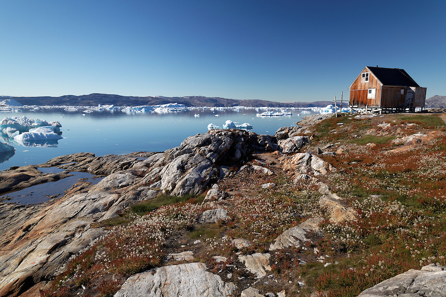 Red house in settlement of Tiniteqilaaq on Sermilik Fjord, East Greenland