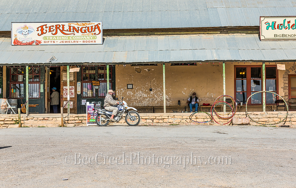 The front porch in Terlingua is a popular gathering place for locals who have a very  laid back lifestyle.  This guy stopped by on his moter bike to talk to the guy sitting on the porch smoking his cigarette or whatever as what happens in Terlingua stays in Terlingua.