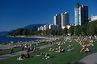 People relaxing on the shores of English Bay, Vancouver, British Columbia, Canada