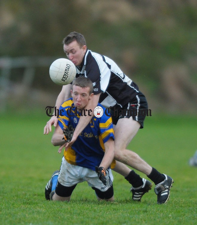 Patrick Kelly of Clarecastle in action against XXX of Michael Cusack's during their Junior A football final at Corofin. Photograph by John Kelly.