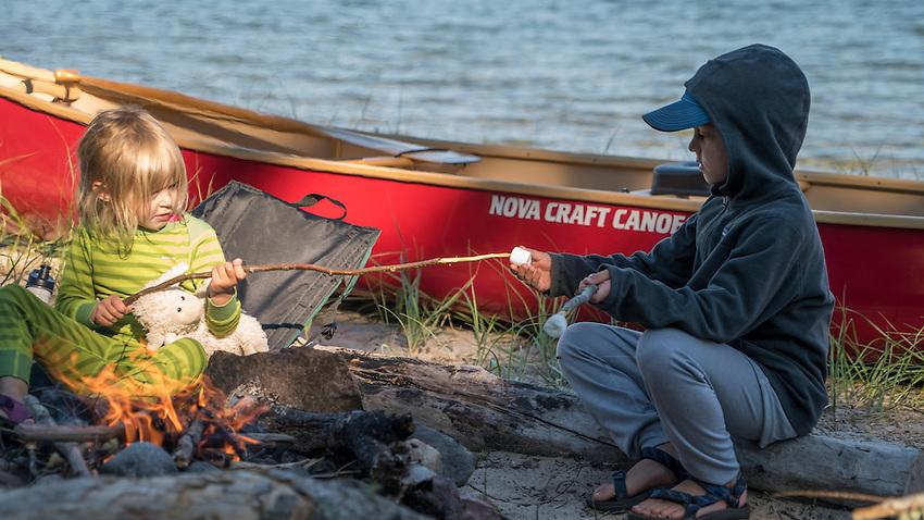 Toasting marshmallows wile canoe camping at Lake Superior Provincial Park, Ontario, Canada.