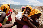 Members of a work crew digging a drainage ditch along the edges of the Corail camp take a break on July 6, 2010 in Port-au-Prince, Haiti. The camp, located far on the outskirts of the city, houses mostly people who chose to leave the crowded camp located on a former golf course in Petionville.