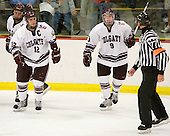 Brian Day (Colgate - 12) and Austin Smith (Colgate - 9) celebrate after Smith's empty net goal at 19:38 of the third secures Colgate's win. - The host Colgate University Raiders defeated the Army Black Knights 3-1 in the first Cape Cod Classic at the Hyannis Youth and Community Center in Hyannis, MA.
