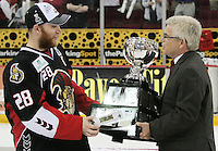 AHL president Dave Andrews, right, presents the Calder Cup trophy to Binghamton Senators captain Ryan Keller after game six of the AHL Calder Cup Finals between the Binghamton Senators and the Houston Aeros, Tuesday, June 7, 2011, in Houston. Binghamton won 3-2 to win the championship. (Darren Abate/pressphotointl.com/AHL)