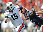 Auburn quarterback Clint Moseley (15) is chased by Mississippi defensive end Cameron Whigham (55) at Vaught-Hemingway Stadium in Oxford, Miss. on Saturday, October 13, 2012. (AP Photo/Oxford Eagle, Bruce Newman)..