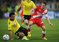FUSSBALL   DFB POKAL   SAISON 2011/2012  ACHTELFINALE  Fortuna Duesseldorf - Borussia Dortmund              20.12.2011 Patrick Owomoyela (li, Borussia Dortmund) gegen Andreas Lambertz (re, Duesseldorf)