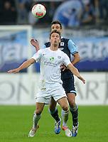 Fussball 2. Bundesliga:  Saison   2012/2013,    10. Spieltag  TSV 1860 Muenchen - FC Erzgebirge Aue  22.10.2012 Jakub Sylvestr (li, FC Erzgebirge Aue) gegen Guillermo Vallori (1860 Muenchen)