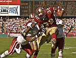 San Francisco 49ers running back Kevan Barlow (32) leaps past Arizona Cardinals linebacker Ronald McKinnon (57) to make touchdown on Sunday, October 27, 2002, in San Francisco, California. The 49ers defeated the Cardinals 38-28.  .