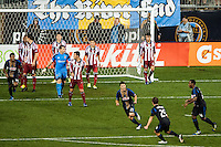 Michael Farfan (21) of the Philadelphia Union celebrates scoring. The Philadelphia Union defeated the CD Chivas USA 3-1 during a Major League Soccer (MLS) match at PPL Park in Chester, PA, on July 12, 2013.