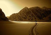 A climber skis on the Ruth Glacier below Peak 11,300 in the Alaska Range.
