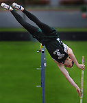 "Wilson's Brett McNeil brushes the bar but clears 15' 2"" during the PIL track finals at Marshall HS. The height is a new track record and school record for Wilson."