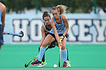 18 September 2015: North Carolina's Eva van't Hoog (NED) (22) and Louisville's Katie Walsh (behind). The University of North Carolina Tar Heels hosted the University of Louisville Cardinals at Francis E. Henry Stadium in Chapel Hill, North Carolina in a 2015 NCAA Division I Field Hockey match. UNC won the game 5-0.