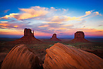 Sunset across Monument Valley and the Mittens. Monument Valley, Arizona.